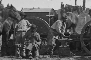 Union army blacksmiths working on a portable forge