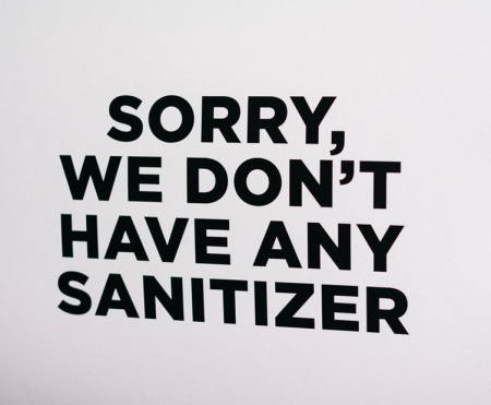 signboard informing unavailability of sanitizers